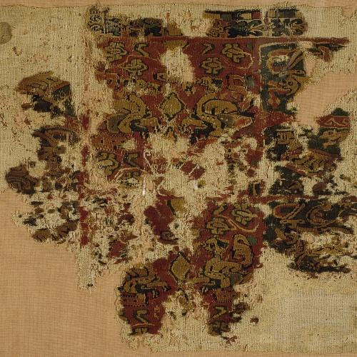 Anònim - Fragment de teixit copte amb flora, animals fantàstics i un bust - Egipte, segle IX